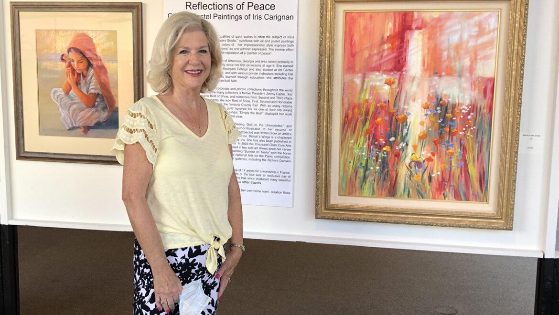 Iris Carignan at the art exhibit.